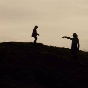 Two people on a hill