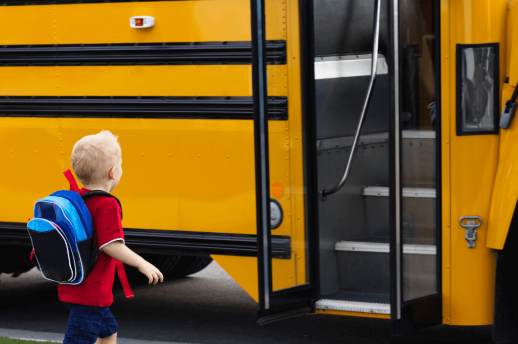 Boy walking onto school bus